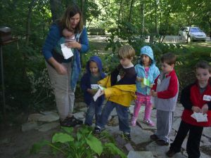 Dr. Carla Gull leads a few of the Nature Preschool children on a color hike in Woodlawn's woods.