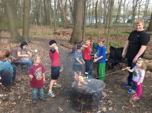 Members host a campfire after a service project.